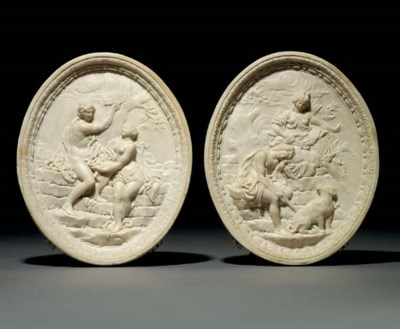 A PAIR OF CARVED MARBLE RELIEF