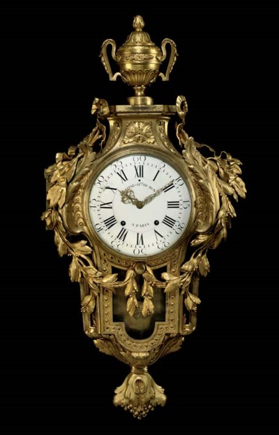 A LATE LOUIS XV ORMOLU CARTEL