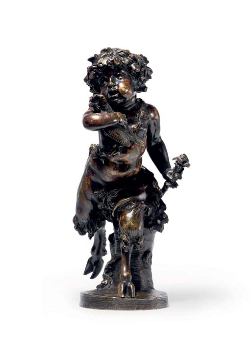 A BRONZE FIGURE OF AN INFANT F