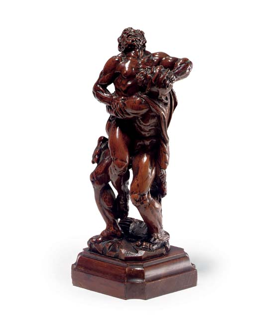 A CARVED BOXWOOD GROUP OF HERC