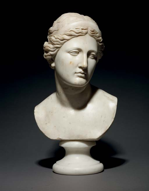 A CARVED MARBLE BUST OF A WOMA