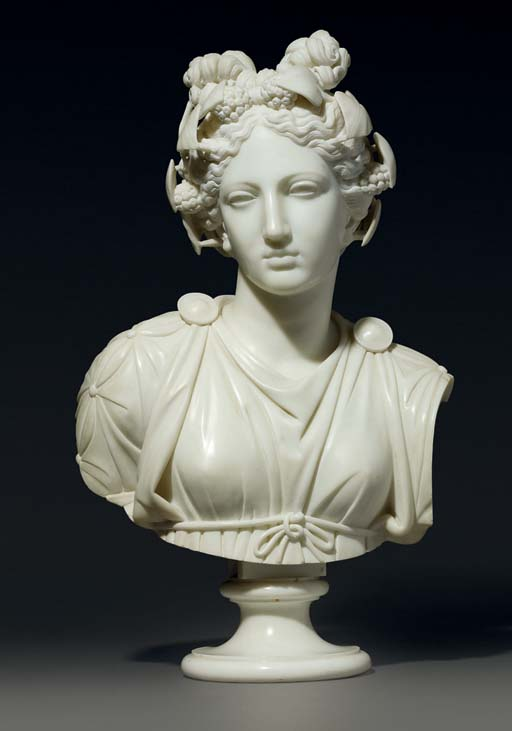 A CARVED MARBLE BUST OF THALIA