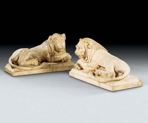 A PAIR OF TERRACOTTA LIONS