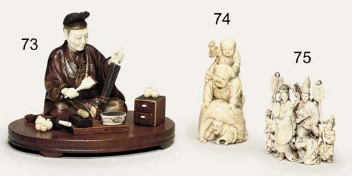 AN IVORY OKIMONO [SCULPTURAL ORNAMENT]