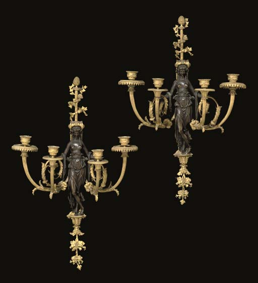 A FINE PAIR OF LOUIS XVI STYLE ORMOLU AND PATINATED BRONZE FOUR-LIGHT WALL-APPLIQUES
