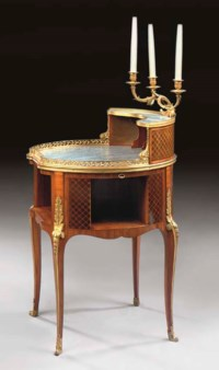 A TRANSITIONAL STYLE ORMOLU-MOUNTED MAHOGANY AND PARQUETRY WRITING-TABLE