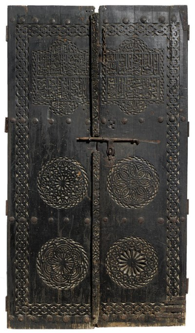 A PAIR OF CARVED WOODEN DOORS