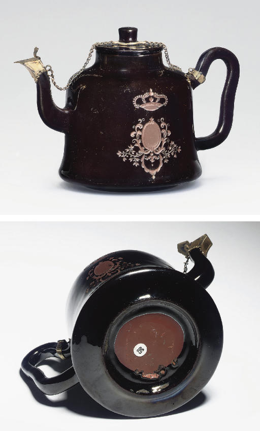 A BÖTTGER BLACK GLAZED SILVER-GILT-MOUNTED RED STONEWARE TEAPOT AND COVER