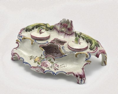 A CONTINENTAL FAIENCE INKSTAND