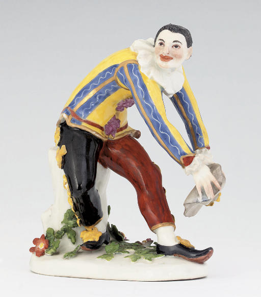 A MEISSEN FIGURE OF THE 'GREETING HARLEQUIN'