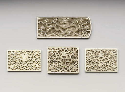 A GROUP OF TEN JADE PLAQUES