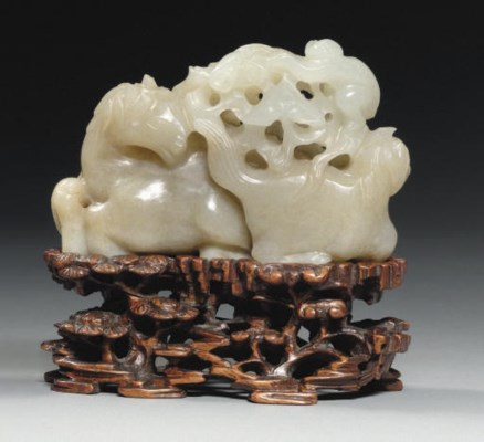 A CELADON JADE CARVING OF TWO