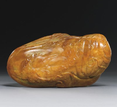 A CARVED HONEY-COLOURED JADE W
