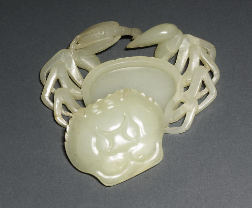 A WHITE JADE BOX IN THE FORM O