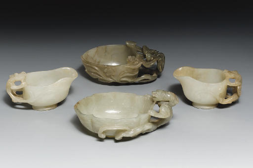 A GROUP OF FOUR CELADON JADE P