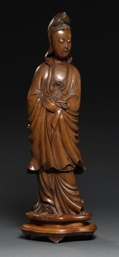 A LARGE BOXWOOD CARVING OF GUA