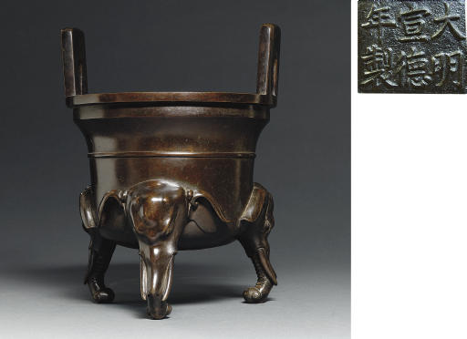 A LARGE BRONZE TRIPOD CENSER