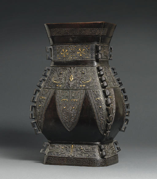 A SILVER AND GOLD INLAID BRONZ