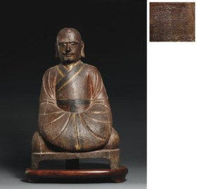 A MING CAST IRON FIGURE OF A LUOHAN