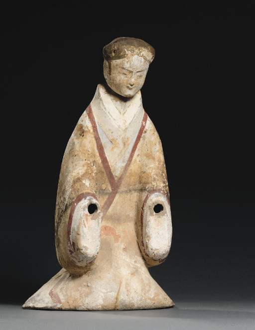 A RARE PAINTED POTTERY FIGURE