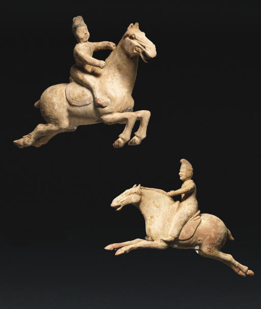 A PAIR OF POTTERY POLO PLAYERS