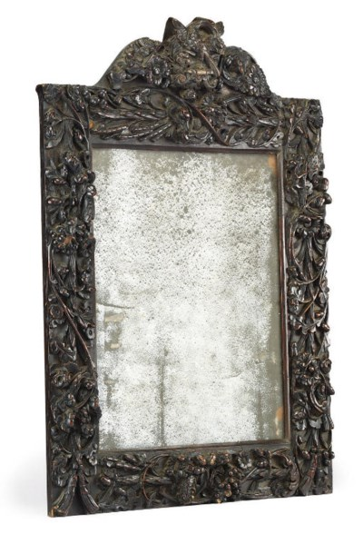 A CARVED WOOD MIRROR FRAME