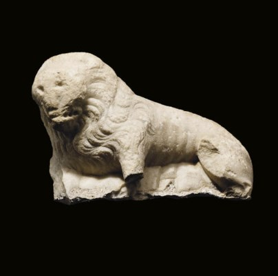A FRAGMENTARY CARVED MARBLE MO