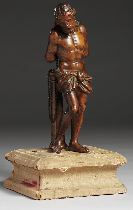 A CARVED FRUITWOOD FIGURE OF C