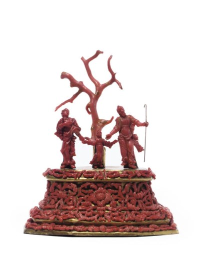 A CARVED CORAL AND GILT-COPPER