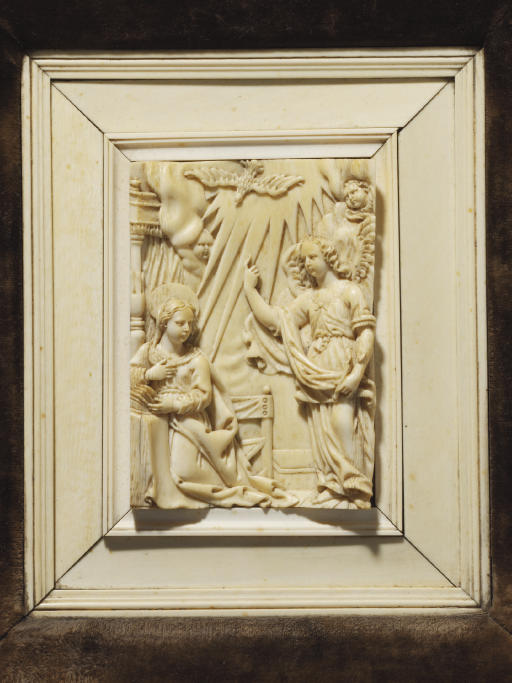 A RECTANGULAR CARVED IVORY REL