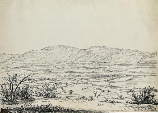View of a broad valley with a distant settlement