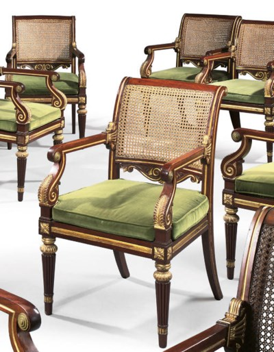 A SET OF TWELVE REGENCY BRASS-