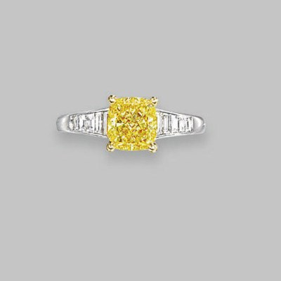 A COLOURED DIAMOND RING, BY GR