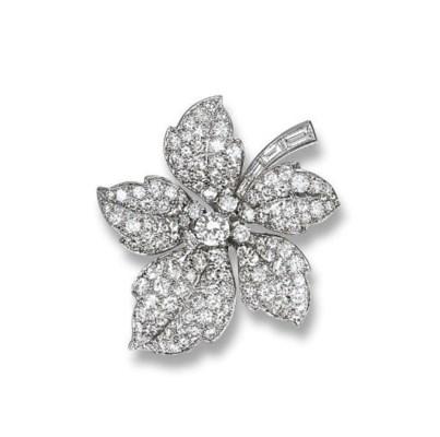 A DIAMOND FLORAL BROOCH, BY CA