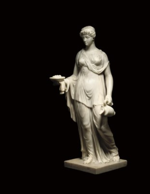 A CARVED MARBLE FIGURE OF A VE