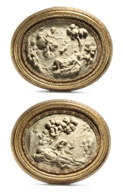 A PAIR OF OVAL CARVED MARBLE R