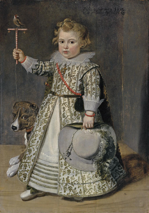 Portrait of boy aged two, full-length, in a white embroidered dress decorated with acorns, holding a perch with a finch in his right hand, with a dog