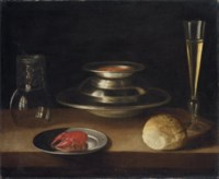 Bread, a carafe of wine, an upturned roemer and a crayfish on a plate with a bowl of soup and glass of wine
