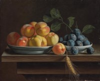 Peaches and plums in white porcelain bowls, with a sheaf of corn on a wooden table