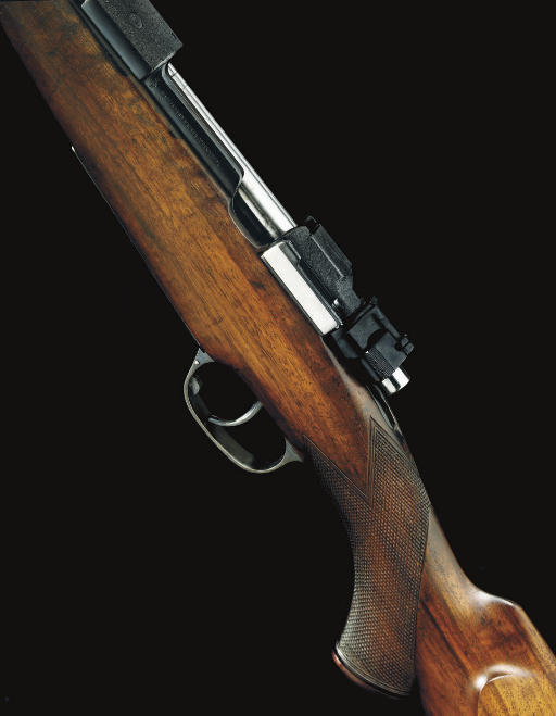 A FINE .375 H&H MAGNUM TAKE-DOWN SPORTING RIFLE BY HOLLAND & HOLLAND, NO. 28142
