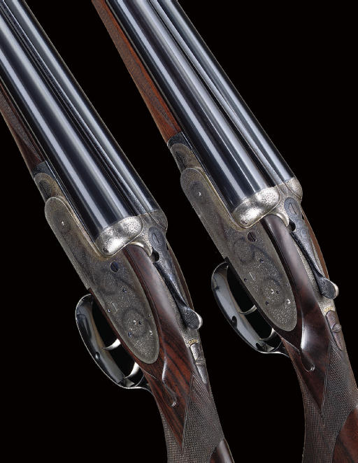 A FINE PAIR OF LIGHTWEIGHT 12-BORE SELF-OPENING SIDELOCK EJECTOR GUNS BY J. PURDEY & SONS, NOS. 23637/8