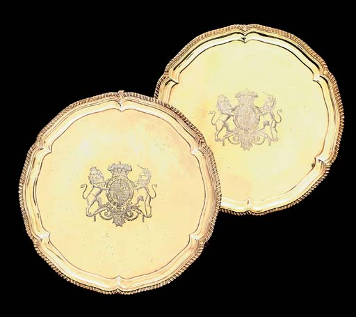 A PAIR OF GEORGE IV ROYAL SILVER-GILT SALVERS