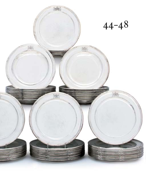 A SET OF TWELVE GEORGE III SILVER SOUP-PLATES
