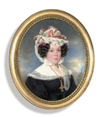 A lady, in black dress with frilled white lace collar, wearing gold chain with a crucifix, frilled lace bonnet with red-bordered white ribbons, dark upswept hair dressed in curls; sky background