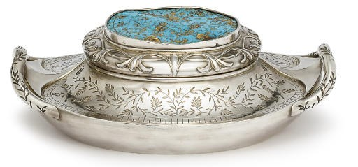 A silver and turquoise box