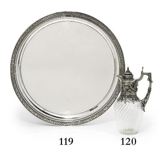 A silver-mounted cut-glass jug