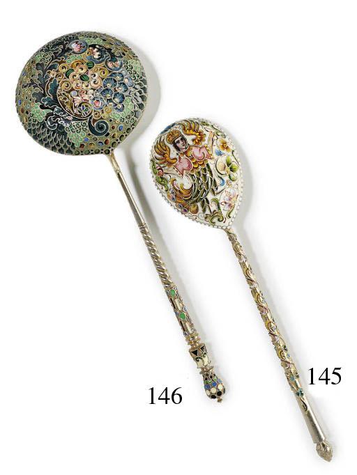 A large silver and cloisonné e