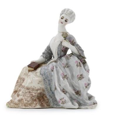 A porcelain figure of a Lady w
