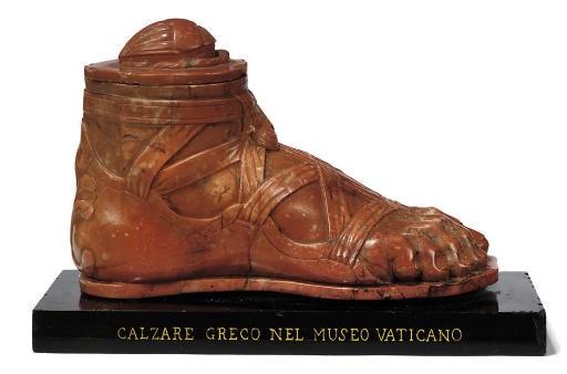 AN ITALIAN SCULPTED ROSSO VERO