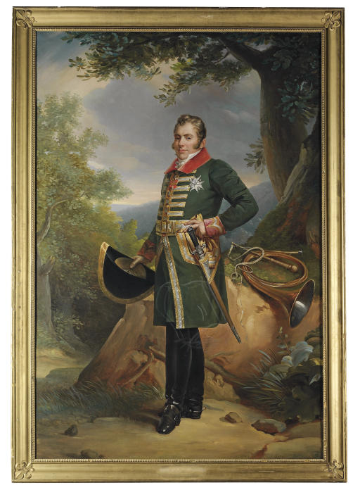 Portrait of Charles-Ferdinand d'Artois, Duc de Berry (1778-1820), in hunting dress, a hat in his right hand, a trumpet on a rock to his left, in a rocky wooded landscape